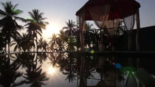 Tropical Sunset at Beach Resort with Swimming Pool