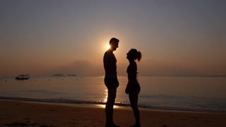 Two People in Love at Sunset on Vacation