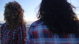 Two Young Hipster Girls on Beach at Sunset