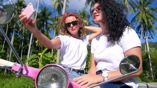 Two Young Women Making Selfie Outdoors