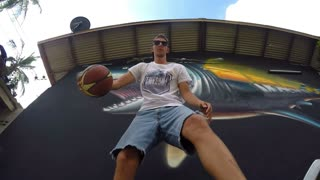 Basketball Player Against Graffiti Wall