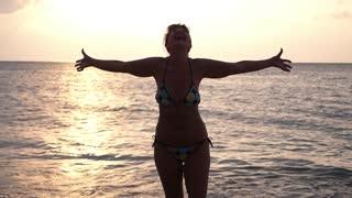Beautiful Mature Middle-Aged Woman at Sunset Beach in Bikini