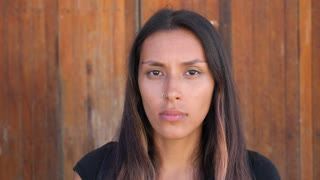 Beautiful Mixed-Race Woman Looking At Camera With Serious Face