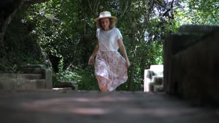 Beautiful Woman Running In Forest In Summer. Slow Motion