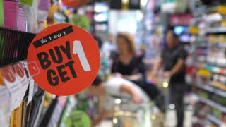 Buy 1 Get 1 Free Promotion Sign In A Supermarket
