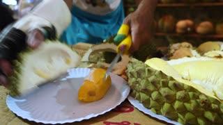 Closeup Of Men Cut Durian Fruits In Thailand