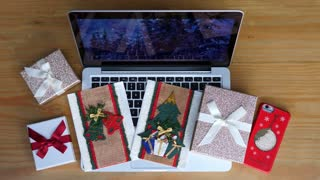 Corporate Christmas Flat Lay With Laptop, Gift Box And Xmas Cards