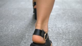 Fashion Female Legs In High Heeled Shoes Walking On Street