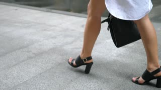 Fashion Female Legs Walking In Shoes Outdoors With Bag. Slow Motion