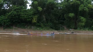 Fishing Boat With Poor Fisherman Children Sailing On River. Laos, 22 August, 2017