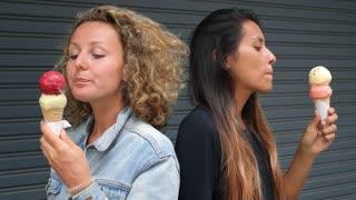 Funny Summer Girls Eating Ice Cream on Street