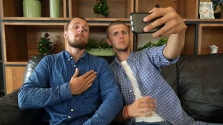 Funny Young Men Taking Selfie In Cafe