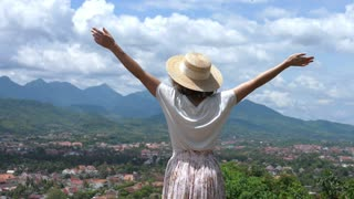 Girl With Arms Wide Open On Top Of Mountain Watching Beautiful Scenery