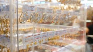 Gold Earrings In Jewelry Store. Closeup