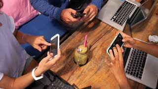 Group of Young People With Smartphone and Laptop at Cafe. Startup or Teamwork Concept.
