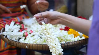 Hand of Asian Women Doing Flowers For Religious Worship