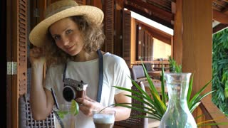 Happy Blonde Female Taking Picture With Camera In Summer Cafe