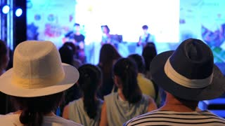 Hipster Couple In Trendy Hats Watching Concert on Stage