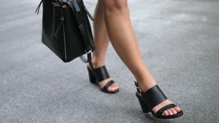 Legs of Woman In Sandals Walking On Street. Slow Motion