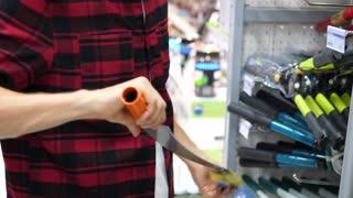 Male Customer Choosing Building Materials In Hardware Store