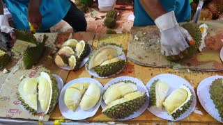 Men Cutting Durian Fruits