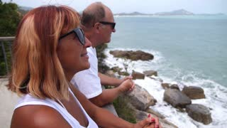 Middle-Aged Couple Looking at Sea