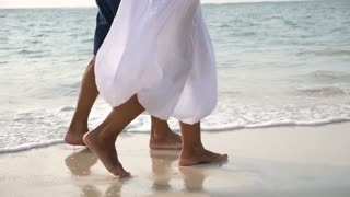 Middle Aged Couple Walking on Beach. Travel Vacation Retirement Lifestyle Concept