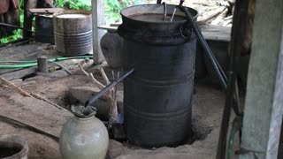 Moonshine Still in Action at Home Alcohol Machine In Laos