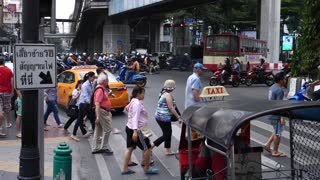 Pedestrians Crossing Intersection in Crowded City Center. Cinematic Slow Motion.