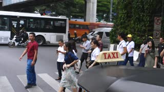 People Crossing Intersection in City Center In Rush Hour. Cinematic Slow Motion.