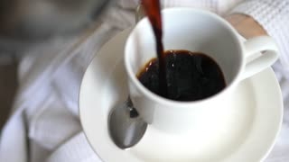 Pouring Black Coffee In Cup