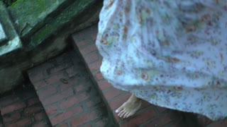 Romantic Woman Running Barefoot On Stairs