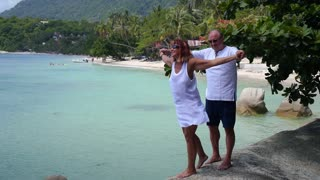 Senior Couple On Tropical Beach By The Sea