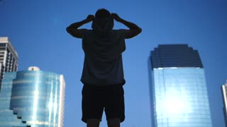 Successful Sport Man Raising Arms After Running In City