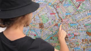 Tourist Woman Exploring City Map On Europe Trip Vacation. BERLIN, GERMANY, 12 AUG, 2018.