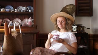 Woman Drinking Tea Or Coffee In Vintage Cafe In Summer