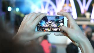 Woman Hands Capturing Video on Mobile Phone at Concert