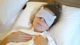 Woman In Bed In Sleeping Mask