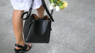 Woman Legs In Shoes Walking Outdoors With Bag. Fashion Lifestyle