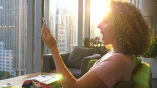 Young Excited Woman Speaking By Smartphone With City View