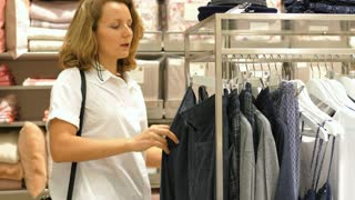 Young Fashion Woman Shopping For Clothes In Clothing Store