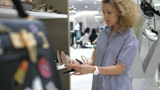 Young Female Shopping For Shoes In Shoe Store