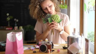 Young Romantic Woman With Flowers Enjoying Morning In Cafe