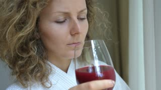 Young Sad Woman In Depression Drinking Wine In Stress. Closeup