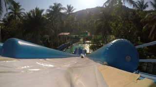 Water Slide at Aquapark. Summer Holiday. Slow Motion.