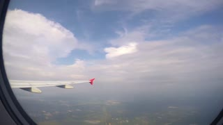 Wing of Airplane from Window. Timelapse.