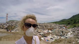 Woman at Garbage Dump Reports About Ecological Catastrophe