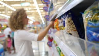Woman at Supermarket Choosing Food
