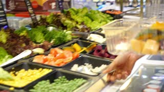 Woman Buying Food at Salad Bar. Healthy Lifestyle and Diet