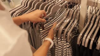 Woman Customer Shopping in Clothing Store in Shopping Mall